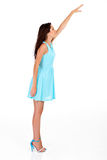 Young woman reaching. Tall young woman reaching for something high stock photos