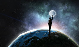 Young woman reaching moon stock image