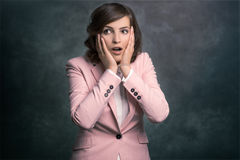 Young woman reacting in shock and horror Stock Images