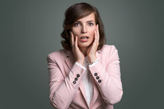 Young woman reacting in shock and horror Royalty Free Stock Images