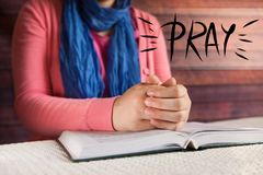 Young woman read Bible and pray, religion and christianity concept royalty free stock image
