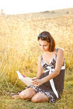 Young woman read book Stock Images