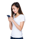 Young woman read the email on mobile phone Stock Image
