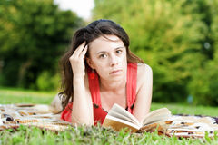 Young woman reading Stock Image