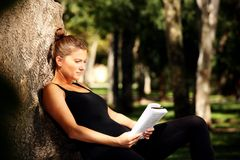 Young woman reading Stock Photos
