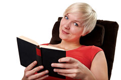 Young woman reading an amusing book Stock Photo