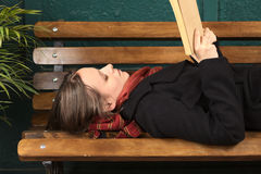 Young Woman Reading on Bench Stock Photos