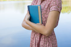 Young woman reading bible in natural park Royalty Free Stock Images
