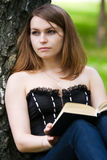 Young woman reading a book. Stock Images
