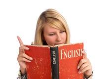 Young woman reading a book Stock Photos
