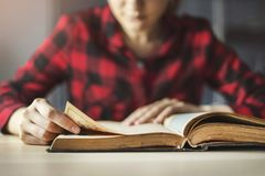 Young woman is reading book stock images