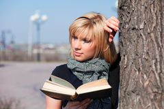 Young woman reading a book. Royalty Free Stock Photo