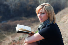 Young woman reading a book. Royalty Free Stock Photography