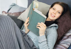 Young woman reading a book stock photo