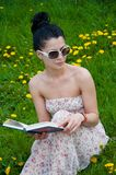 Young woman reading a book Stock Images