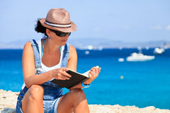 Young woman reading a book. Stock Photo