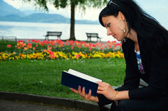 Young woman reading a book Stock Photos