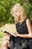 Young woman reading book Stock Images