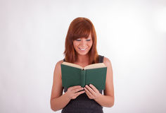 A young woman is reading a book Stock Photography