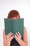 A young woman is reading a book Stock Photo