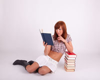A young woman is reading a book Stock Images