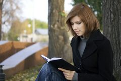 Young woman reading a book Royalty Free Stock Photo