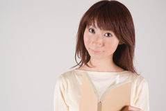 Young woman reading book. Young Asian woman reading book Royalty Free Stock Photo