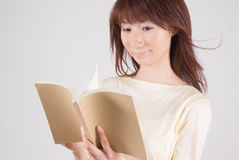 Young woman reading book. Young Asian woman reading book Royalty Free Stock Images