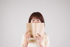 Young woman reading book Stock Photos