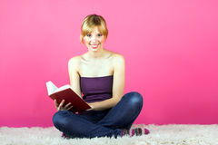 Young woman reading a book Stock Photography