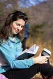 Young woman reading a book in an autumn park Stock Photography