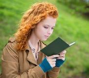 Young woman reading a book. Stock Photos