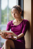 Young woman reading book in college Royalty Free Stock Image