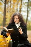 Young woman reading book and drinkin coffee Royalty Free Stock Images