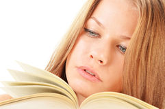 Young woman reading a book. Female student learning Royalty Free Stock Image