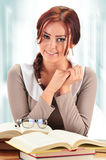 Young woman reading a book. Female student learning Royalty Free Stock Photos