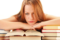 Young woman reading a book. Female student learning Stock Image
