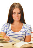 Young woman reading a book. Female student learning. On white background Royalty Free Stock Photos