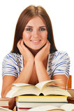 Young woman reading a book. Female student learning. On white background Royalty Free Stock Image