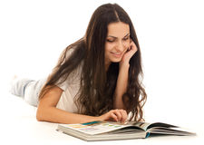 Young woman reading book on floor isolated Stock Image