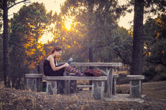Young woman reading a book in the forest Royalty Free Stock Image