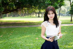 Young woman reading a book in garden Royalty Free Stock Images
