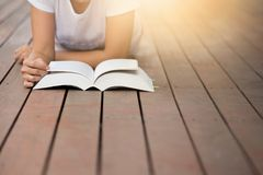Young woman reading book in her hands. royalty free stock photo