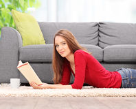 Young woman reading a book at home Royalty Free Stock Photo
