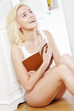 Young woman reading a book at home Royalty Free Stock Image
