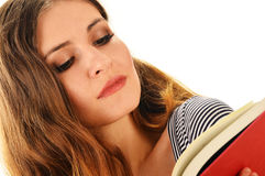 Young woman reading a book isolated on white Stock Image