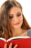 Young woman reading a book isolated on white Royalty Free Stock Photos