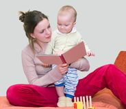 Young woman reading book with kid royalty free stock image