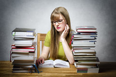 Young woman is reading book royalty free stock photo