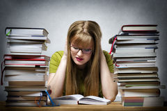 Young woman is reading book stock photos